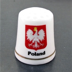 This porcelain thimble has the Polish eagle against a red background. Beautiful collector's item. Poland on one side and Polska on the reverse.