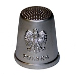 This silver-colored metal thimble features the classic Polish eagle on the front.  A beautiful collector's item.