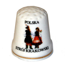 This porcelain thimble has a dancing couple from Krakow.  Beautiful collector's item.