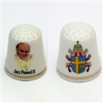 This porcelain thimble features Pope John Paul II on the front and the papal insignia on the reverse.  Beautiful collector's item.