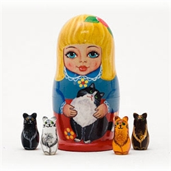 A winsome blond maid and her feline friend decorate this outer doll -- but wait, there's a surprise inside! When you open the doll, 4 different miniature cat figurines can be found. A delight for cat lovers.