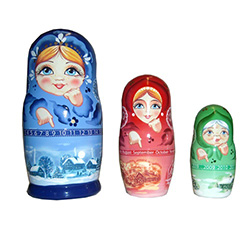 Set of three hand painted nesting dolls depicting ladies in three stages of life: a child, an adult, and an old lady.  In each doll, their finger points to either the month, the day or the year (from 2010 to 2019).  This can be used on your desk as a 10-y