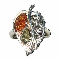 Honey and Green Amber stones set into a sterling silver leaf.