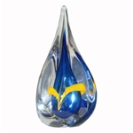 Four-sided art glass paperweight, with a cobalt-blue interior core, surrounded by a yellow ribbon and a few bubbles, in a classic teardrop shape. Each piece is hand blown and hand finished in Poland. Made with the highest quality craftsmanship and hand-si