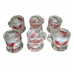 "Set of (6) clear shot glasses, emblazoned on one side with the Polish eagle against a red & white banner, and the famous saying: ""Na Zdrowie - Cheers!"" on the other side."