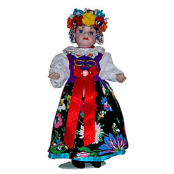 With porcelain head, arms & legs, and hand made authentic Slask (Silesian) dress, this is a beautiful doll! Please note that dress materials are unique and vary from doll to doll so no two are exactly alike. Stand included.