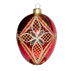 The egg is the symbol of new life and the  cross represents Christ's triumphant victory.  Hand blown and decorated with Swarovski crystals.  Beautiful red and gold colors.