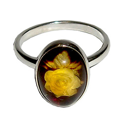 Unique and lovely honey amber rose blossom set in sterling silver ring!  The exquisitely detailed rose design is hand-carved from the reverse side of the amber.