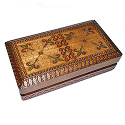 This box is decorated with a dual floral design created and accented with metal inlay.