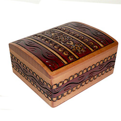 Curved-top box. treasure-chest style, with a hand painted and burned design.