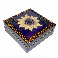 Violet colored box with a hand painted and burned flower design.