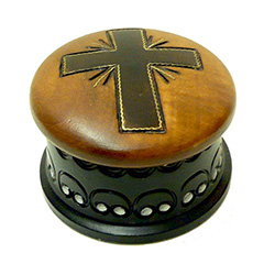 Round hand-painted box with a cross on the lid.