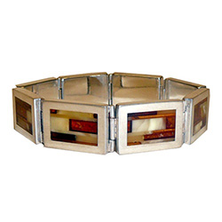 Simply gorgeous men's sterling silver bracelet, with an inlaid mosaic pattern of yellow, cream, honey, and cherry amber stones.