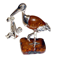 Honey amber and sterling silver stork carrying a new born baby in his beak.  Exquisite hand craftsmanship.  Unique and very beautiful.