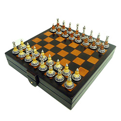 Exquisitely beautiful hand-crafted sterling silver and amber chess set.  Pieces have black felt bottoms and have a nice weight and feel.  This set includes custom tooled-leather covered wooden case