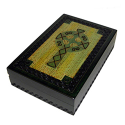 This Irish green box has hand carved cross design with a detailed border around the lid and the sides of the box. Metal inlay accents the lid border and cross pattern.