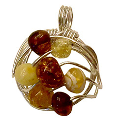 Very original contemporary design wire-woven multi-color amber pendant, in a semi-circle shape.  Amber beads are honey, citrine, cream-colored and cognac.  Matching earrings - see item 9814030.