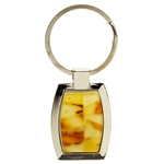 "Classy chrome and amber key chain, with inlaid rectangles of honey, and cream Baltic amber. Great souvenir gift.  Size approx 3"" x 1.1""."