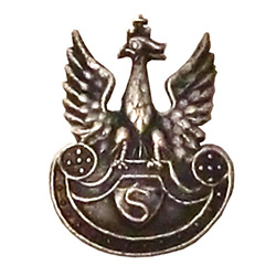First military organization formed by Jozef Pilsudski to train future soldiers for an independent Poland.  Eagle was worn on caps of the cadre (Kadrowka). Eagle perched on a shield with the letter S for Rifle (Strzelecki) in the center.  This is a mini re