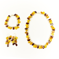 Matching set earrings, bracelet and necklace. Outstanding value! Archaeological evidence of Baltic amber's use as a trade commodity dates back to 8000 B.C., and it is recorded that Phoenician sea-traders carried amber throughout the known world four thous