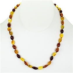 Lovely necklace composed of cherry, custard, light and dark honey Amber.