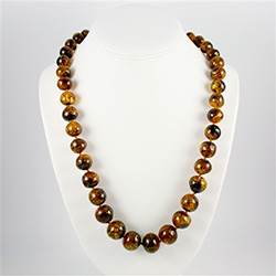 "Natural Baltic amber necklace.  Knotted between each bead.  Bead size varies from .3"" to .6"" diameter.  Beautiful coloration."
