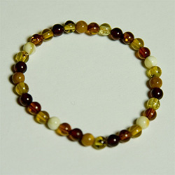 "Dainty 5"" - 13cm Bracelet composed of milky, honey, and cherry shades of round Baltic Amber beads.