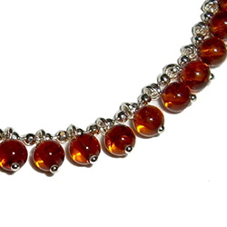 "7.5"" Honey Amber Charm Bracelet; Circular Honey Amber beads on Sterling Silver w/claw clasp."