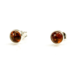 Honey Amber Earrings with Sterling Silver setting and post backs.  Amber is soft, only slightly harder than talc, and should be treated with care.Amber is soft, only slightly harder than talc, and should be treated with care.