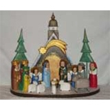The Holy Family and in particular the Nativity is a popular theme in Polish folk art.   This is the work of Jerzy Zrbozek