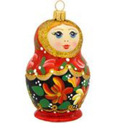 "This little dear is sure to be a real doll in your collection! Our 3½"" tall Matryoshka doll ornament showcases Poland's craftsmanship at its finest. Modeled after Russian nesting dolls, this unique glass ornament is masterfully painted with glittering acc"
