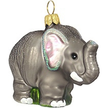 "This adorable elephant is ready to stampede his way into your heart and onto your tree this Holiday Season! With vivid glazes and sparkling glitter accents, this 2"" tall elephant ornament is artfully crafted of glass from Poland."