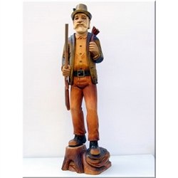 "This is a very tall (18"") hand carved and stained figure of a forest huntsman carry his shotgun.  Very nicely detailed.