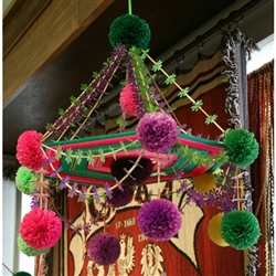 This pajak comes from the town of Nieborow, not far from Lowicz.  It is made with tissue paper, straw and feature a center of colorful yarns.   Some have strings of beads and no two are ever alike.  Completely made by hand by our local artist, each takes