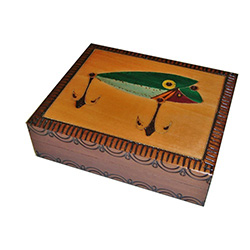 This beautiful box is made of seasoned Linden wood, from the Tatra Mountain region of Poland and features a stylized fishing lure.  The lure is painted, burned and inlaid with brass.
