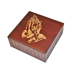 This beautiful box is made of seasoned Linden wood, from the Tatra Mountain region of Poland and features praying hands etched in the top.