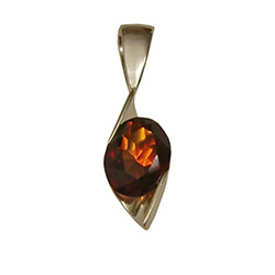 Multi-facted honey amber suspended in a stylized silver pendant resembling a clef note.
