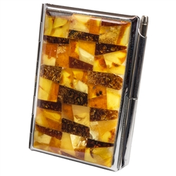 Unique and beautifully hand-crafted amber mosaic combination business card and note pad holder with pen.  Artistic mosaic of varied colored and shaped amber pieces applied to the top of a stainless steel business card holder. Spring clip to hold down busi