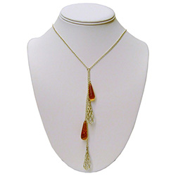Very elegant use of sterling silver and amber formed into tear drop shapes hanging delicately on a sterling silver chain.