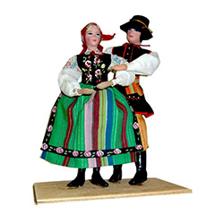 Just west of Warsaw is the town of Lowicz and the center of a region famous for its variety of folk art and colorful costumes.  Our couple are featured in their traditional striped costumes.