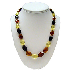 Alternating light, dark and clear multi-faceted and polished amber beads.  Each bead is knotted.