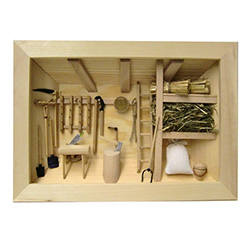 Poland has a long history of craftsmen working with wood in southern Poland. Their workshops produce beautiful hand made boxes, plates and carvings.  This shadow box is a look inside a traditional Polish farmer's barn.  Note the nice attention to detail.