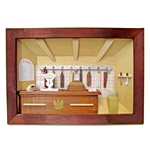 Poland has a long history of craftsmen working with wood in southern Poland. Their workshops produce beautiful hand made boxes, plates and carvings.  This shadow box is a look inside a traditional butcher shop - Price list in Polish.