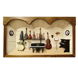 Poland has a long history of craftsmen working with wood in southern Poland. Their workshops produce beautiful hand made boxes, plates and carvings.  This shadow box is a look inside a traditional Polish music room.