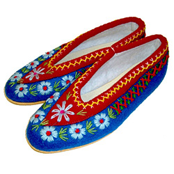 These Polish highland slippers are made from wool and are hand made and stitched. They are very comfortable, lightweight and feature cushy rubber like soles. Intended primarily as for indoor use.  They come in a variety of two-tone colors and while we
