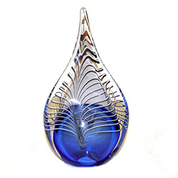 Two-sided art glass paperweight, with a gorgeous blue interior core with a peackock feather design, in a classic teardrop shape.  Each piece is hand blown in Poland.  Made with the highest quality craftsmanship and hand-signed by the artist.