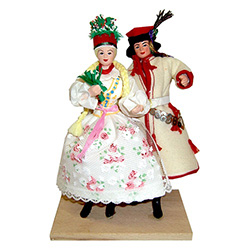 The Krakow costume is considered to be Poland's national folk costume and is certainly the best known.  Our couple are dressed in the traditional wedding costumes from Krakow.  Notice the emphasis on white in both the bride's dress and the groom's coat.