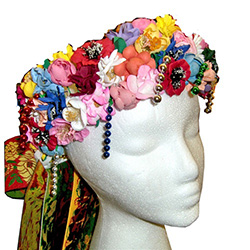 "Beautiful handmade flowered headpiece for the Slask costume with 30"" long attached set of ribbons.  Ribbon set is easy to detach if required.  The intricate designs on the ribbons are woven rather than printed for a rather stunning appearance."