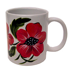 Beautiful hand painted red poppies on this white ceramic mug. No two alike.  Hand wash only.