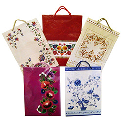 Delightful Polish folk themed paper gift bags are the perfect way to present those special gifts.  Glossy color paper with cloth handles, cardboard bottom insert for added strength and all made in Poland.  Set of 5 different patterns.
